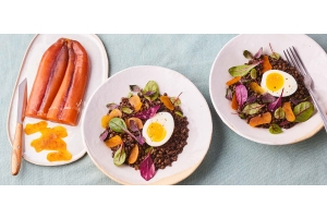Beluga lentil salad, soft-boiled eggs, baby leaf salad and Bottarga